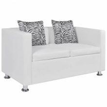 Fehér kétszemélyes műbőr kanapé zebramintás párnával